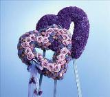 Double Heart Shades of Lavender (CF027-11) Funeral Flowers, Sympathy Flowers, Funeral Flower Arrangements from San Francisco Funeral Flowers.com Search for sympathy and funeral flower arrangement ideas from our SanFranciscoFuneralFlowers.com website. Our funeral and sympathy arrangements include crosses, casket covers, hearts, wreaths on wood easels. Open 365 days and provide delivery everyday including Sunday delivery to funeral homes from San Francisco CA to San Mateo CA. San Francisco Flowers