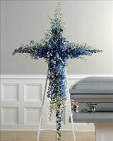 Delphinium Cross (CF026-21) Funeral Flowers, Sympathy Flowers, Funeral Flower Arrangements from San Francisco Funeral Flowers.com Search for sympathy and funeral flower arrangement ideas from our SanFranciscoFuneralFlowers.com website. Our funeral and sympathy arrangements include crosses, casket covers, hearts, wreaths on wood easels. Open 365 days and provide delivery everyday including Sunday delivery to funeral homes from San Francisco CA to San Mateo CA. San Francisco Flowers
