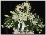 Casket Spray White Casablanca Lilies, Soft Pink Roses, Heart Funeral Flowers, Sympathy Flowers, Funeral Flower Arrangements from San Francisco Funeral Flowers.com Search for sympathy and funeral flower arrangement ideas from our SanFranciscoFuneralFlowers.com website. Our funeral and sympathy arrangements include crosses, casket covers, hearts, wreaths on wood easels. Open 365 days and provide delivery everyday including Sunday delivery to funeral homes from San Francisco CA to San Mateo CA. San Francisco Flowers