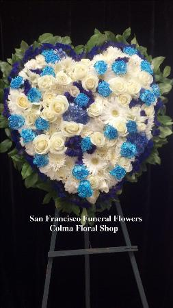 Blue and white medley solid heart Funeral Flowers, Sympathy Flowers, Funeral Flower Arrangements from San Francisco Funeral Flowers.com Search for chinese funeral, sympathy funeral flower arrangements from our SanFranciscoFuneralFlowers.com website. Our funeral and sympathy arrangements include crosses, casket covers, hearts, wreaths on wood easels, coronas fúnebres, arreglos fúnebres, cruces para velorio, coronas para difunto, arreglos fúnebres, Florerias, Floreria, arreglos florales, corona funebre, coronas