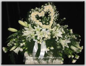 Casket Spray White Casablanca Lilies, Soft Pink Roses, Heart Funeral Flowers, Sympathy Flowers, Funeral Flower Arrangements from San Francisco Funeral Flowers.com Search for chinese funeral, sympathy funeral flower arrangements from our SanFranciscoFuneralFlowers.com website. Our funeral and sympathy arrangements include crosses, casket covers, hearts, wreaths on wood easels, coronas fúnebres, arreglos fúnebres, cruces para velorio, coronas para difunto, arreglos fúnebres, Florerias, Floreria, arreglos florales, corona funebre, coronas