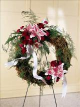Lily & Rose Wreath Funeral Flowers, Sympathy Flowers, Funeral Flower Arrangements from San Francisco Funeral Flowers.com Search for sympathy and funeral flower arrangement ideas from our SanFranciscoFuneralFlowers.com website. Our funeral and sympathy arrangements include crosses, casket covers, hearts, wreaths on wood easels. Open 365 days and provide delivery everyday including Sunday delivery to funeral homes from San Francisco CA to San Mateo CA. San Francisco Flowers